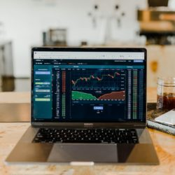 investment graphs on laptop