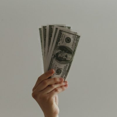 person holding dollars in their hand