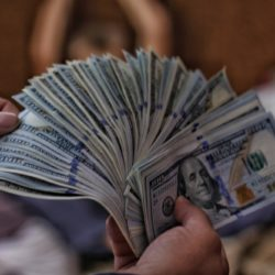 person holding money